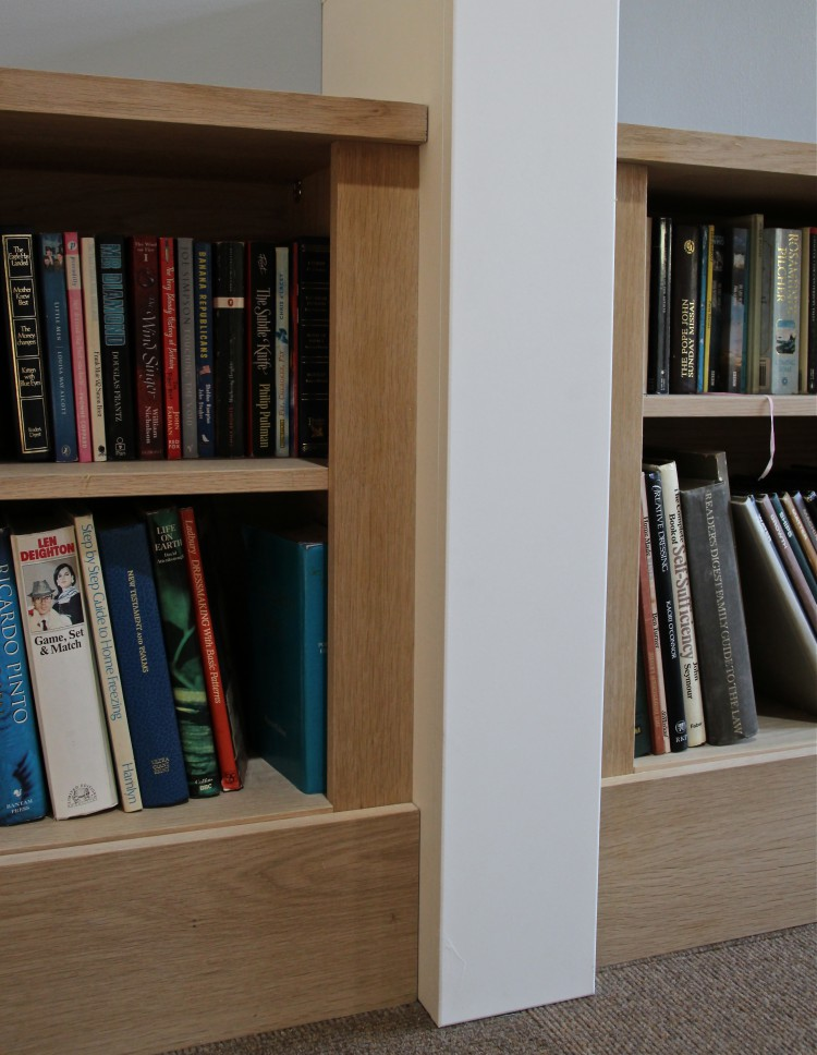 Bespoke Jali bookcases in real oak veneer, designed to fit against walls