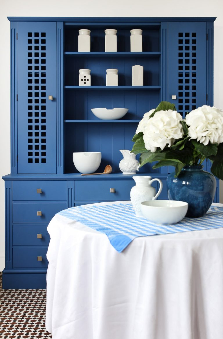 Blue dresser with white china
