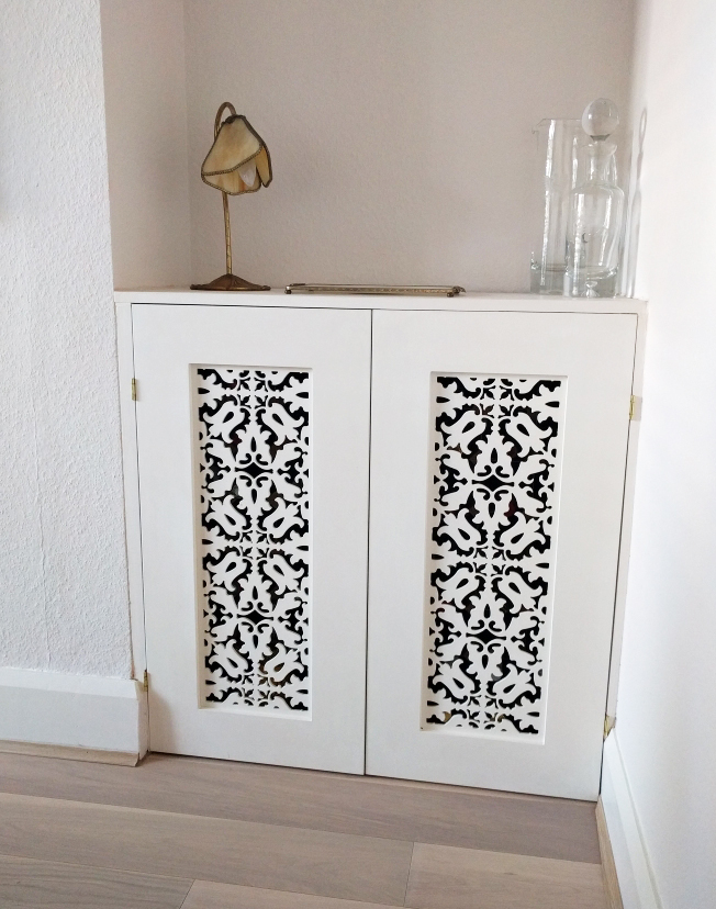 Fretwork Doors used to Create an Alcove Cupboard