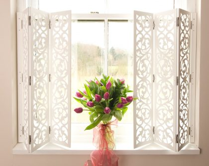 Ornate White Shutters Transform a Window