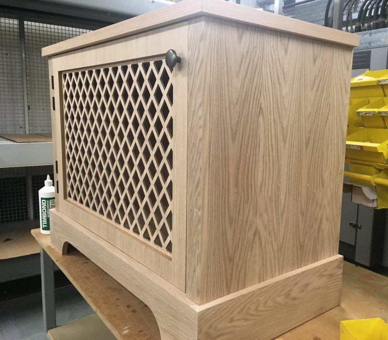 Large oak cupboard in the assembly area