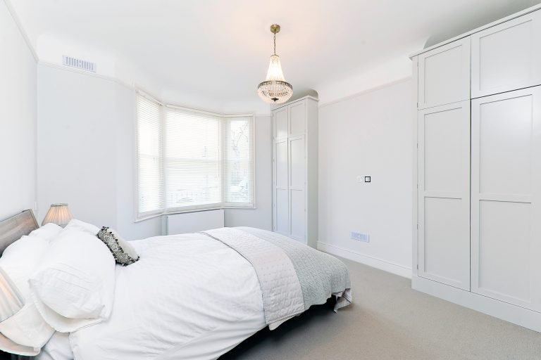 White wardrobes with panelled doors