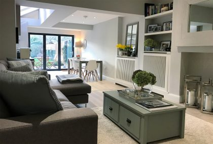 An Open Plan Living Room with White Top Coat Radiator Covers