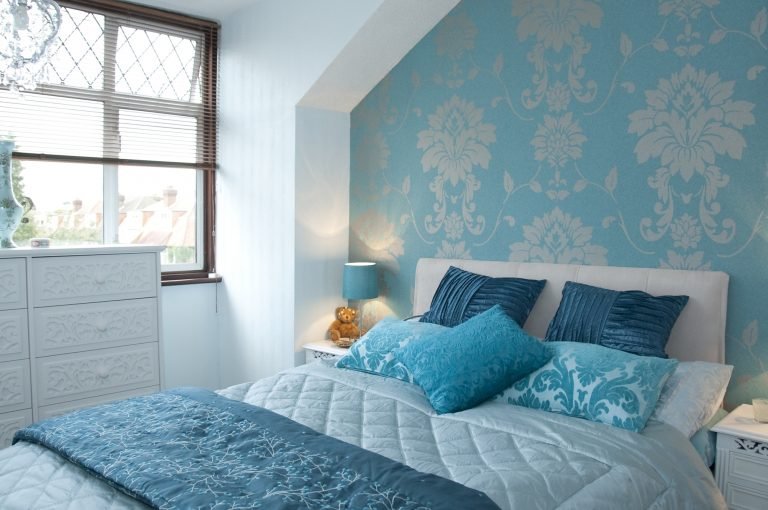 White Top Coat Drawers Showcased in a Sophisticated Blue Bedroom