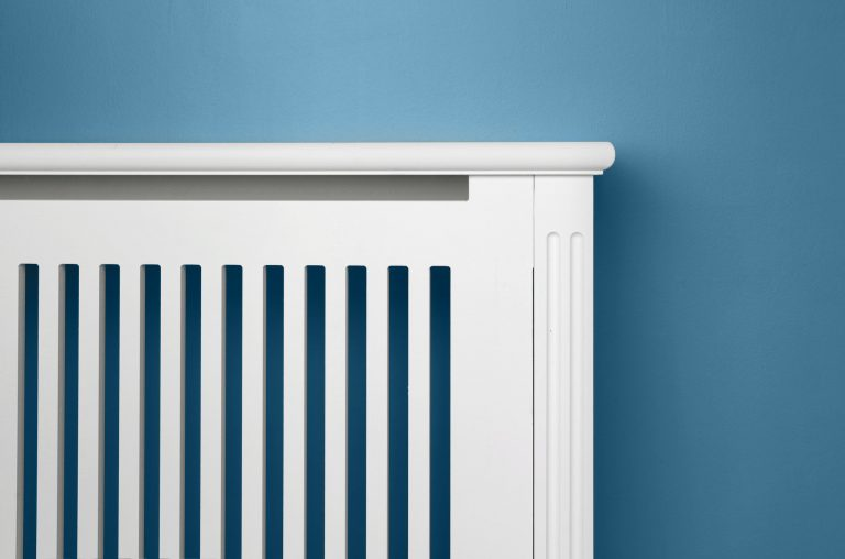 Contemporary radiator cabinet on blue wall