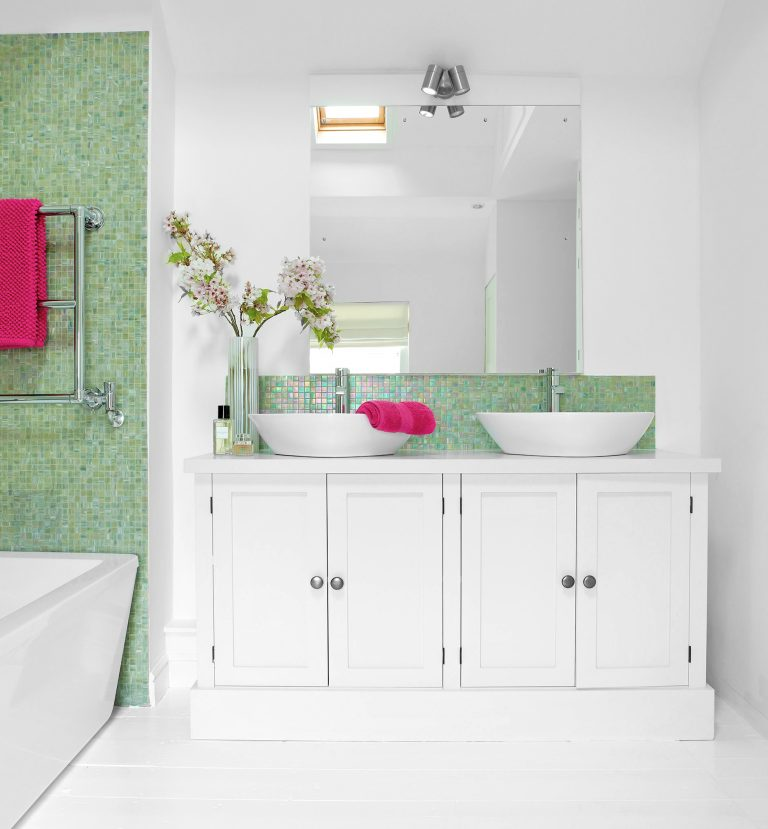 White Cabinet in Bathroom Alcove with Sinks