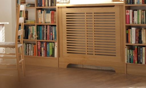A cabinet fitted across an alcove